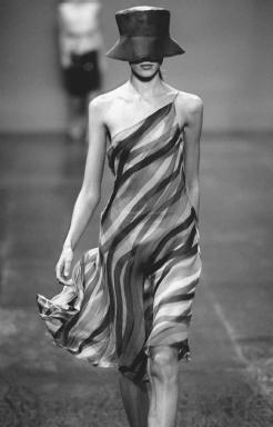 Max Azria, designed for BCBG Max Azria's 2000 collection: silk chiffon dress with an organdy hat. © AP/Wide World Photos.