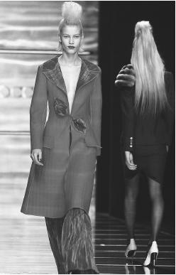 Rocco Barocco, fall/winter 2001-02 collection: coat with satin trim and collar, and satin pants. © AP/Wide World Photos.