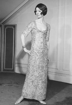 Marc Bohan, designed for the house of Christian Dior's spring 1964 collection: gold-embroidered tulle gown. © Bettmann/CORBIS.