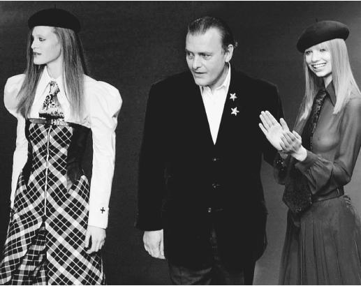 Jean-Charles de Castelbajac and two of his designs following the presentation of his fall/winter 2001-02 collection. © AP/Wide World Photos.