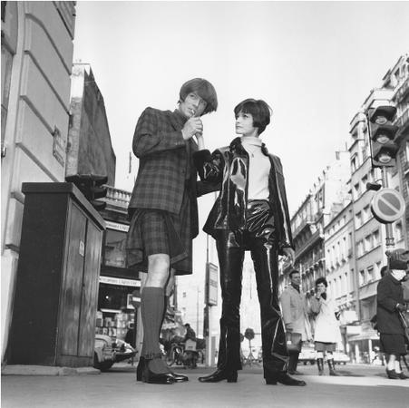 "Jacques Esterel, 1966 collections: ""Mironton"" (left), a Scottish-style plaid kilt ensemble, and ""False Brother"" (right), a vinyl pantsuit with zipped jacket ensemble. © AP/Wide World Photos."