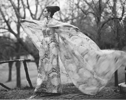 Irene Galitzine, spring 1962 collection: silk gown with a chiffon cape in a pattern designed by her. © Bettmann/CORBIS.