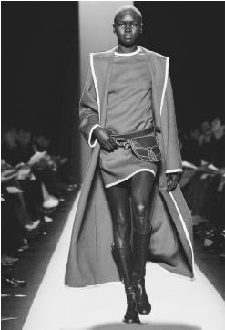 Michael Kors, fall 2001 collection: wool ruana over a merino pullover and stretch flannel britches. © AP/Wide World Photos.