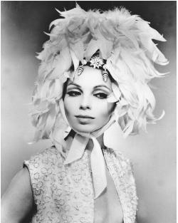 Guy Laroche design, 1965: coq feather bonnet tied with a chiffon kerchief. © AP/Wide World Photos.