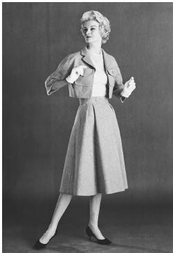 Mainbocher, spring 1958 collection: wool suit with a halter top of lace over shantung. © Bettmann/CORBIS.