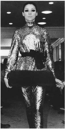 Norman Norell, fall 1968 collection: sequined, fur-trimmed cossack shirt over a narrow skirt. © AP/Wide World Photos.